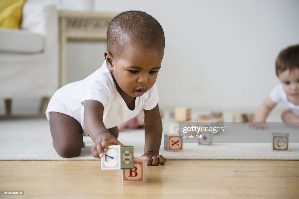 Babies playing with blocks : Stock Photo