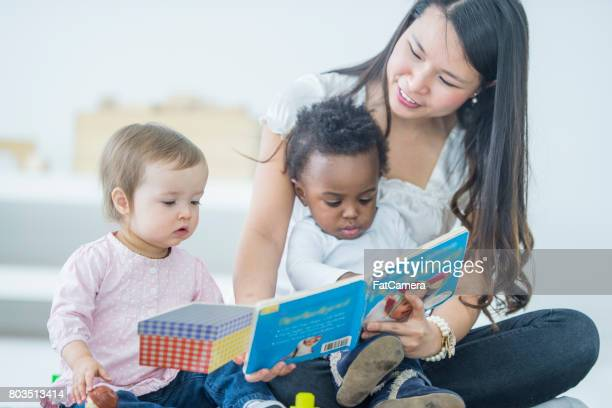 babies reading - child care stock pictures, royalty-free photos & images