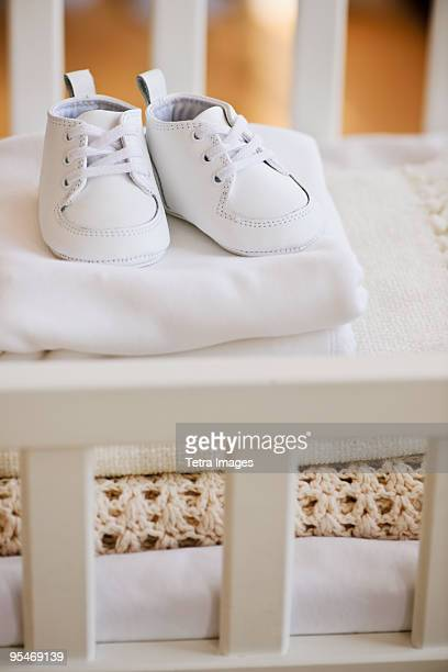 babies shoes - bedclothes stock pictures, royalty-free photos & images