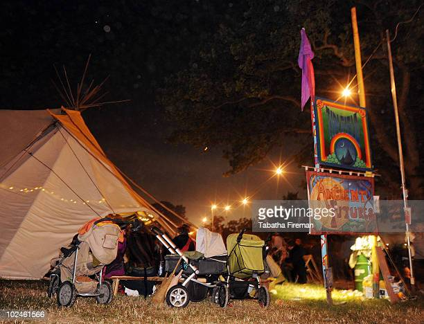 Babies sleep in their buggies whilst their parents continue to party in the Tipi Field during the early hours of the final day at Glastonbury...