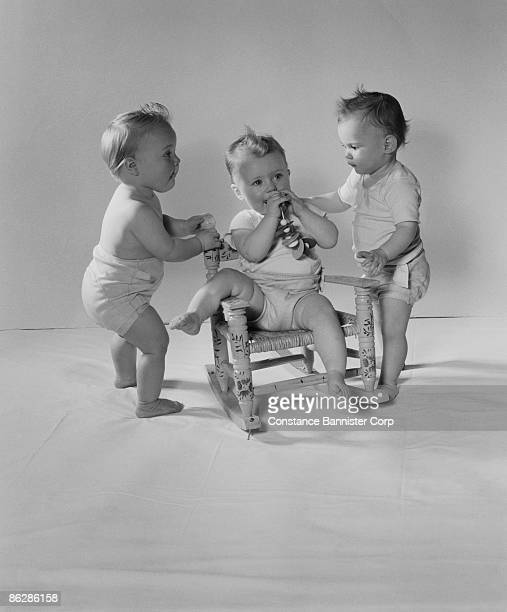 Babies with rocking chair