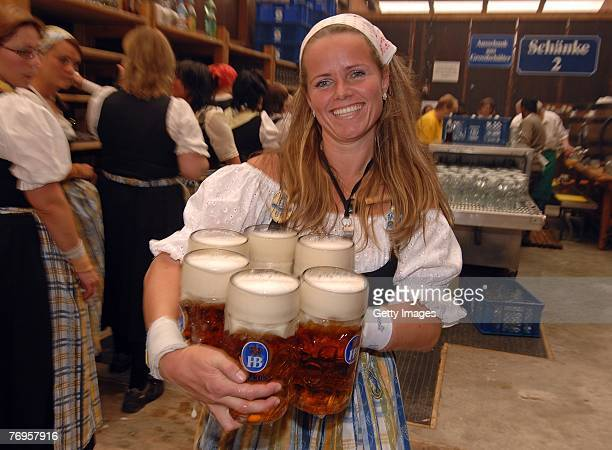 Babsi Stadlhuber Oktoberfests most famous waitress serves hugs of beer in the Hofbraeuhaus tent after the ceremonial opening of the Oktoberfest beer...