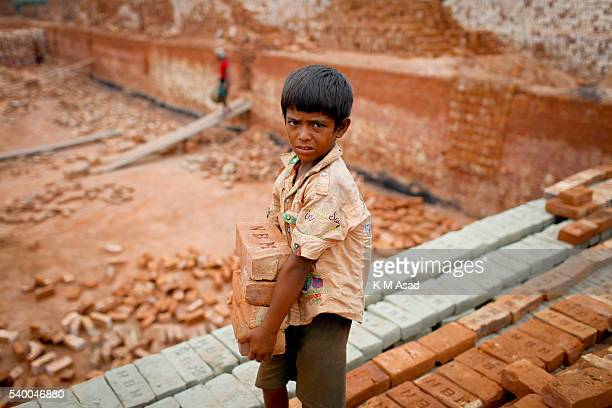 NARAYANGONJ DHAKA BANGLADESH Babu works at a brick factory in Narayangonj Bangladesh June 01 2016 He come this place with his family member This...