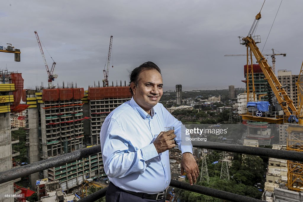 Babulal Varma, managing director and co-founder of Omkar Realtors & Developers Pvt., drinks tea while standing for a photograph at the company's Cresent Bay construction site in the Parel area of Mumbai, India, on Friday, Aug. 15, 2014. Omkar is playing an important role in Mumbais plan to do something about its enormous and embarrassing problem: at least 6.5 million slum dwellers, still living without running water, private toilets or the basics of sanitation. Omkar's Cresent Bay development consists of six luxury towers with million-dollar apartments overlooking the Arabian Sea, coupled with housing blocks nearby with free homes for all the slum dwellers with rights to the land. Photographer: Dhiraj Singh/Bloomberg via Getty Images