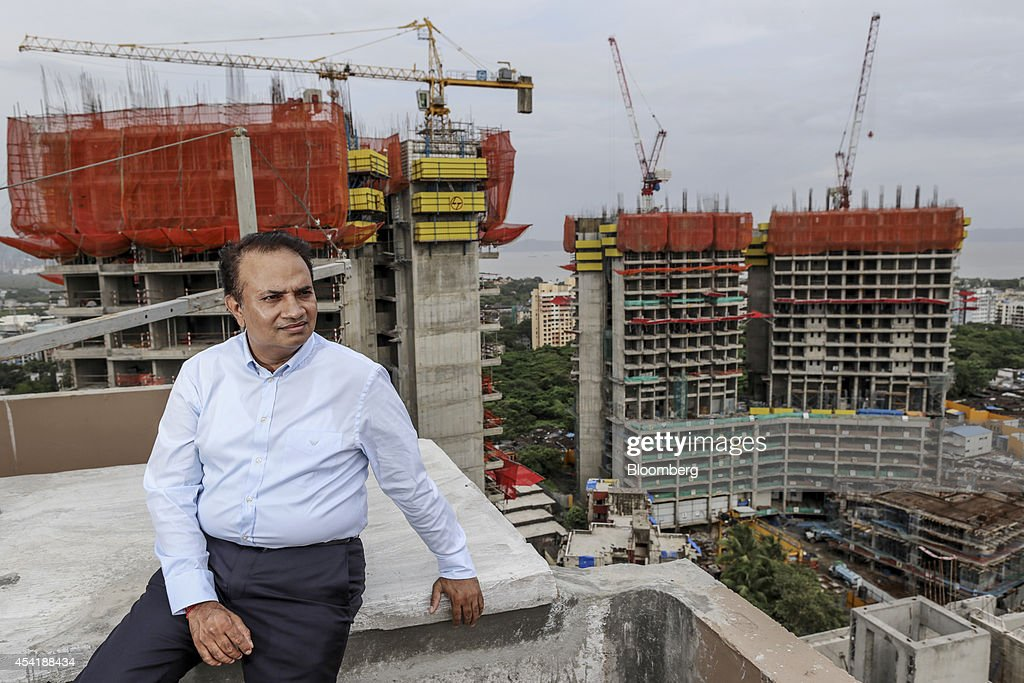 Babulal Varma, managing director and co-founder of Omkar Realtors & Developers Pvt., sits for a photograph at the company's Cresent Bay construction site in the Parel area of Mumbai, India, on Friday, Aug. 15, 2014. Omkar is playing an important role in Mumbais plan to do something about its enormous and embarrassing problem: at least 6.5 million slum dwellers, still living without running water, private toilets or the basics of sanitation. Omkar's Cresent Bay development consists of six luxury towers with million-dollar apartments overlooking the Arabian Sea, coupled with housing blocks nearby with free homes for all the slum dwellers with rights to the land. Photographer: Dhiraj Singh/Bloomberg via Getty Images