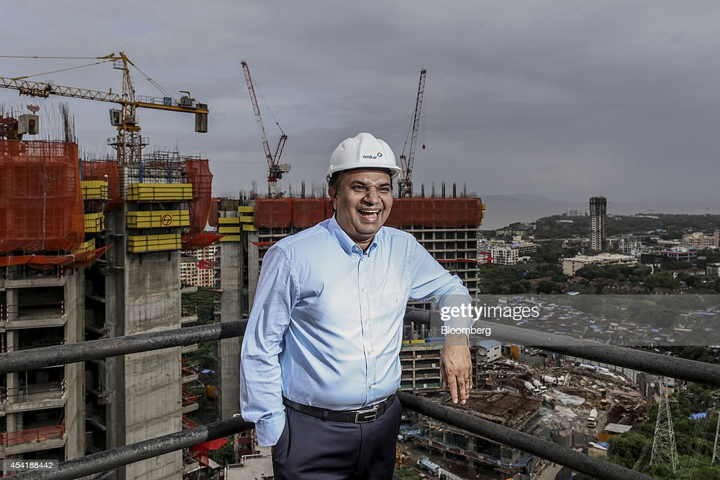 Babulal Varma, managing director and co-founder of Omkar Realtors & Developers Pvt., stands for a photograph at the company's Cresent Bay construction site in the Parel area of Mumbai, India, on Friday, Aug. 15, 2014. Omkar is playing an important role in Mumbais plan to do something about its enormous and embarrassing problem: at least 6.5 million slum dwellers, still living without running water, private toilets or the basics of sanitation. Omkar's Cresent Bay development consists of six luxury towers with million-dollar apartments overlooking the Arabian Sea, coupled with housing blocks nearby with free homes for all the slum dwellers with rights to the land. Photographer: Dhiraj Singh/Bloomberg via Getty Images