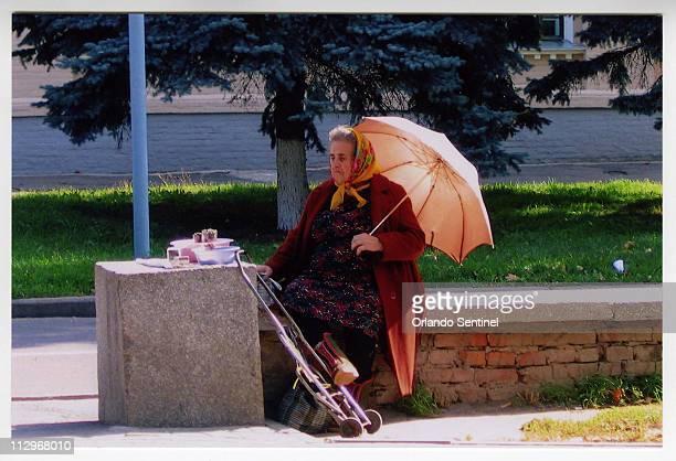 A babushka sells nuts and seeds in Poltava Ukraine