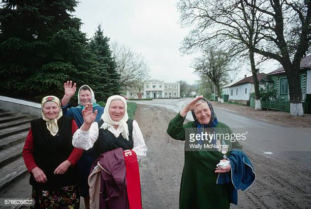 Babushkas from the Lenin Collective Farm near Stavropol wave a friendly goodbye to a visitor | Location Near Stavropol USSR