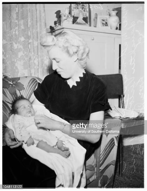 GI Baby 26 June 1951 Mrs Madonna Diem 29 yearsVictoria Marie Diem Caption slip reads 'Photographer Mitchell Date Reporter Stewart Assignement GI baby...