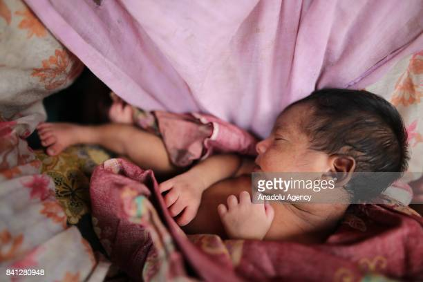 A baby along with Rohingya Muslim people fled from ongoing violence in Myanmars Rakhine state sleeps as a group of Rohingya people arrive to enter no...