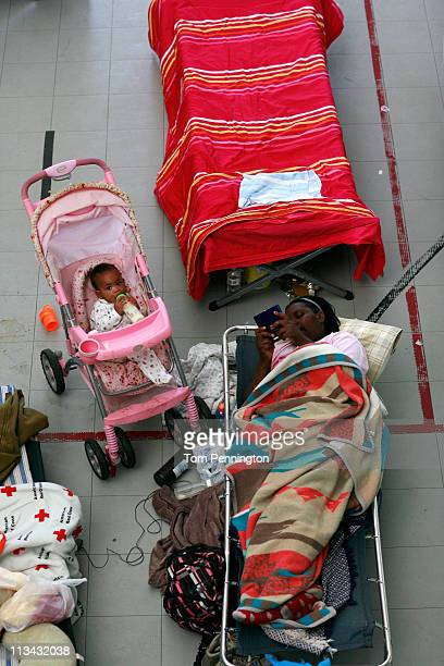 A baby and a woman rest in the sleeping area of a Red Cross Shelter on May 2 2011 in Tuscaloosa Alabama Alabama the hardesthit of six states is...