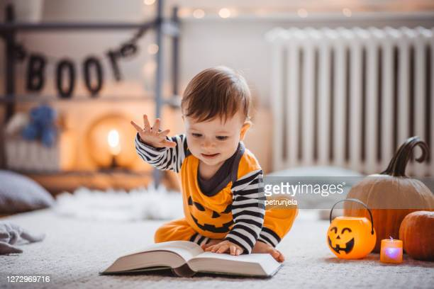 baby and book - one baby boy only stock pictures, royalty-free photos & images