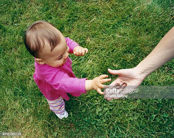 baby and hand with earthworm - earthworm stock pictures, royalty-free photos & images