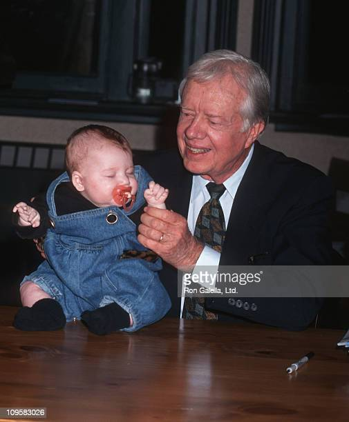 baby and Jimmy Carter during The Little Baby Snoogle Fleejer Autographing Party December 13 1995 at Barnes Noble Bookstore in New York City New York...
