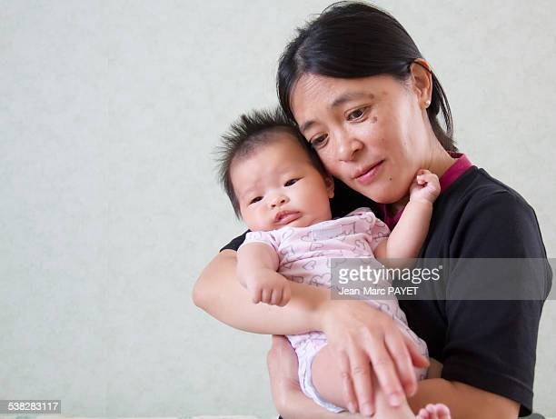 baby and mother - jean marc payet stock pictures, royalty-free photos & images