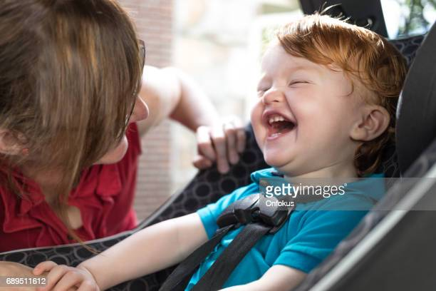 Baby and Mother Strapping in Carseat