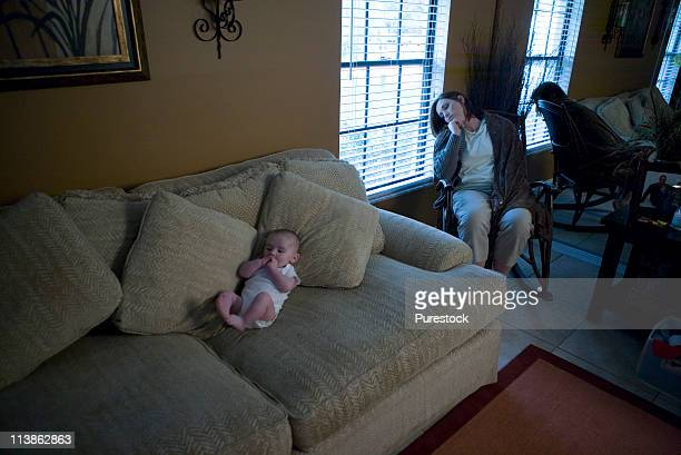 baby and mother suffering from postpartum depression - postpartum depression stock photos and pictures