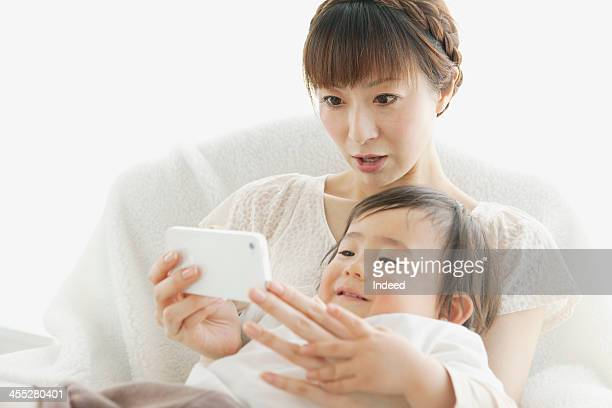 Baby and mother using smartphone