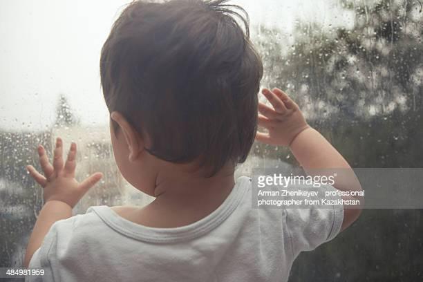 Baby and rain