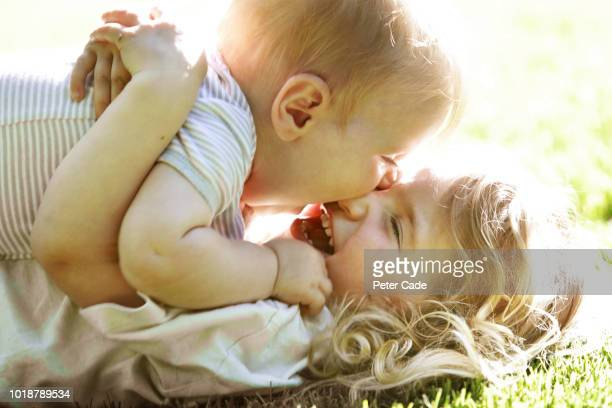 Baby and sister playing on grass