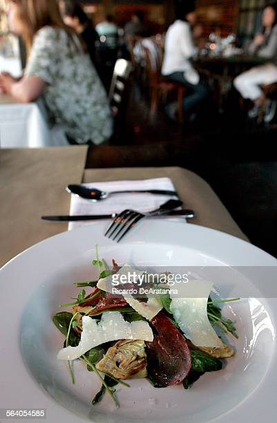 Baby artichokes bresaola arugula and reggianito salad served at 750Ml Restaurant in South Pasadena It has a uniquely urban location with boutiques...