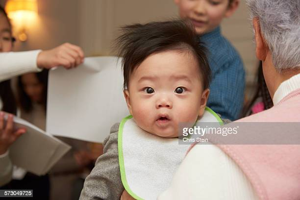 baby asian boy at a party - scarsdale stock photos and pictures