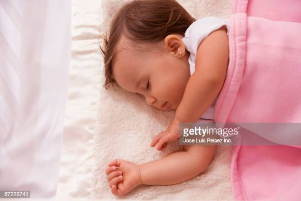 baby asleep in bed - earring stock pictures, royalty-free photos & images