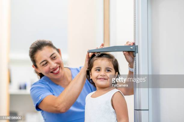 baby at medical appointment - high up stock pictures, royalty-free photos & images