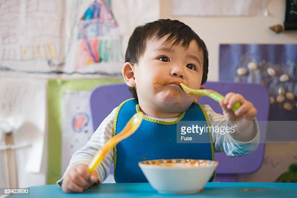 Baby at Table Eating