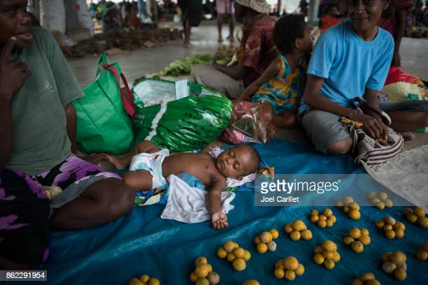 Baby at the Madang market, Papua New Guinea