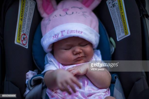A baby attends the Annual Easter parade on April 16 2017 in New York City The Easter Parade and Easter Bonnet Festival is characterized by revelers...