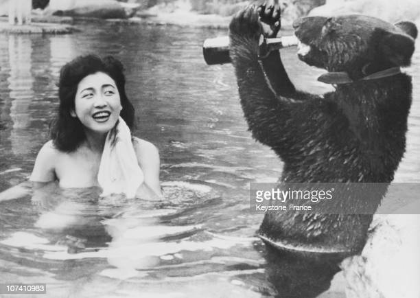 Baby Bear Drinking In Water With Beautiful Young Girl