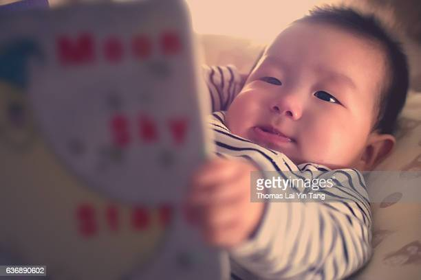 Baby bedtime story book reading