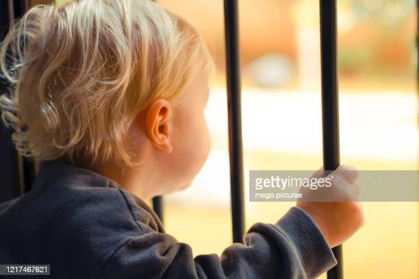 baby behind bars - child behind bars stock pictures, royalty-free photos & images