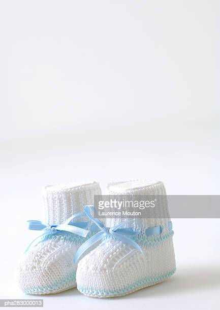 baby booties - baby booties stock photos and pictures