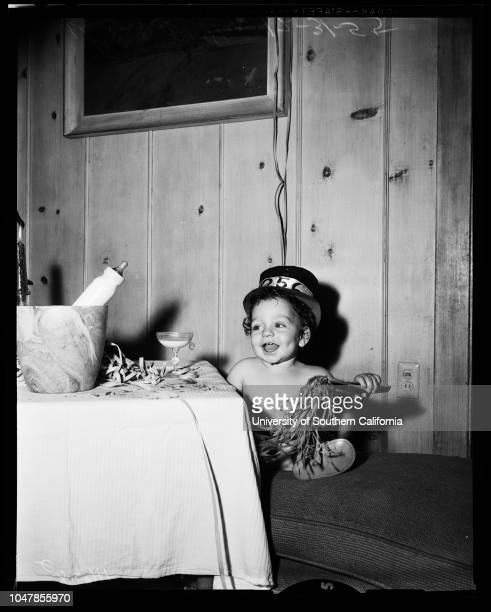 Baby born on New Year last year celebrates 31 December 1955 Shawn O'Shea celebrates with milk in champagne glassCaption slip reads 'Photographer Gaze...
