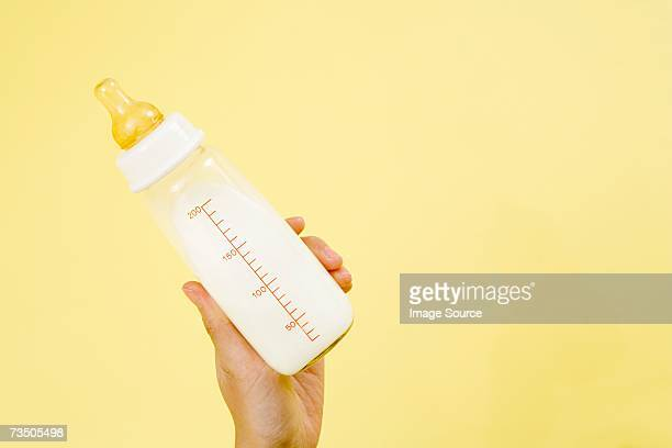 baby bottle containing milk - baby bottle stock pictures, royalty-free photos & images
