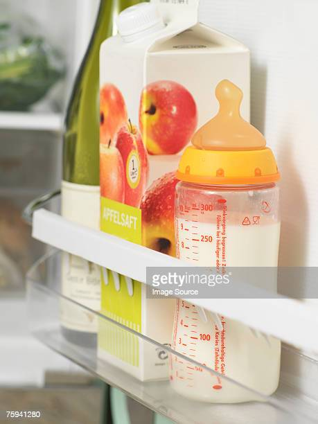 baby bottle in refrigerator - drinks carton stock pictures, royalty-free photos & images