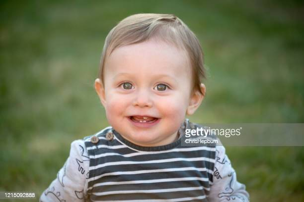 baby boy 10 months old with toothy smile - one baby boy only stock pictures, royalty-free photos & images