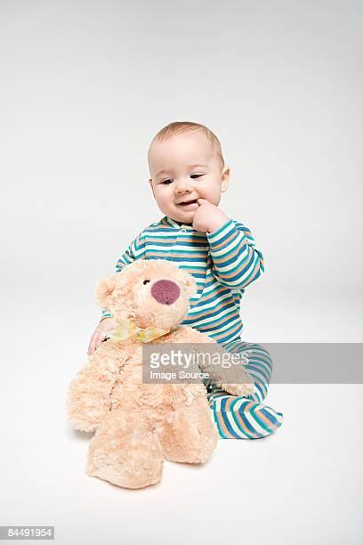 A baby boy and a teddy