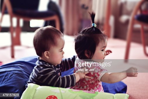 Baby Boy And Baby Girl Cousins Playing Stock Photo Getty