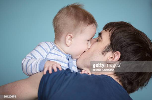 Baby Boy and Daddy kissing
