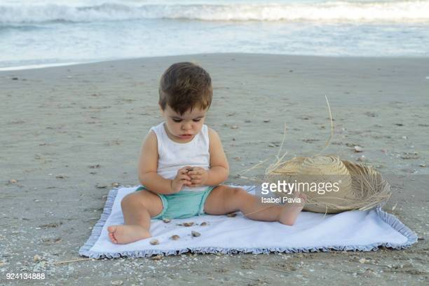 baby boy at beach - one baby boy only stock pictures, royalty-free photos & images
