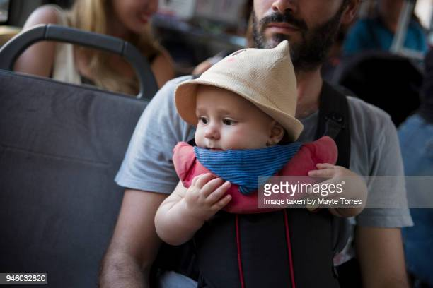 Baby boy at the bus with dad