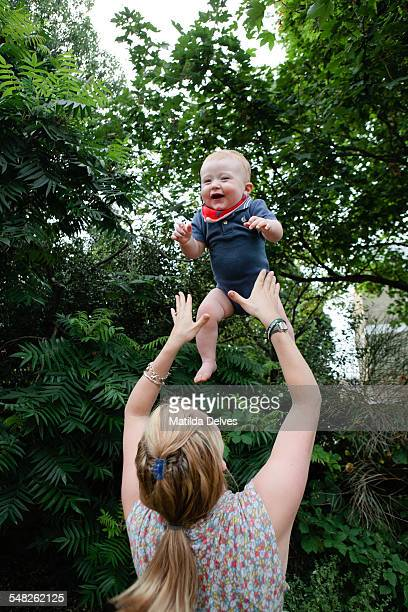 Baby boy (1 year old) being thrown in the air