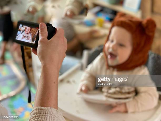 baby boy birthday filming - bear suit stock pictures, royalty-free photos & images
