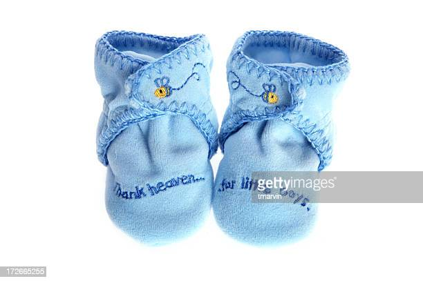 baby boy booties - baby booties stock photos and pictures