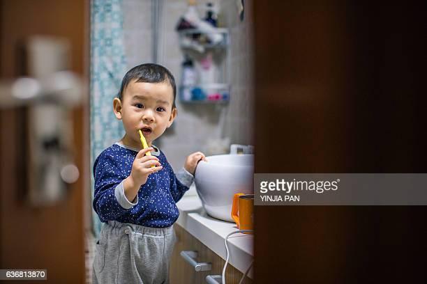 A baby boy brushing his teeth