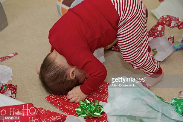 baby boy christmas morning fun - bent over babes stock pictures, royalty-free photos & images