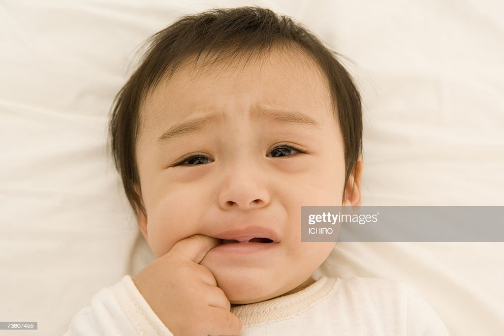 Baby boy (9-12 months) crying : Stock Photo